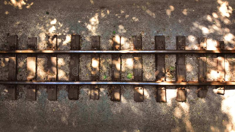 Old railway with wooden sleepers. Background with rails stock photo
