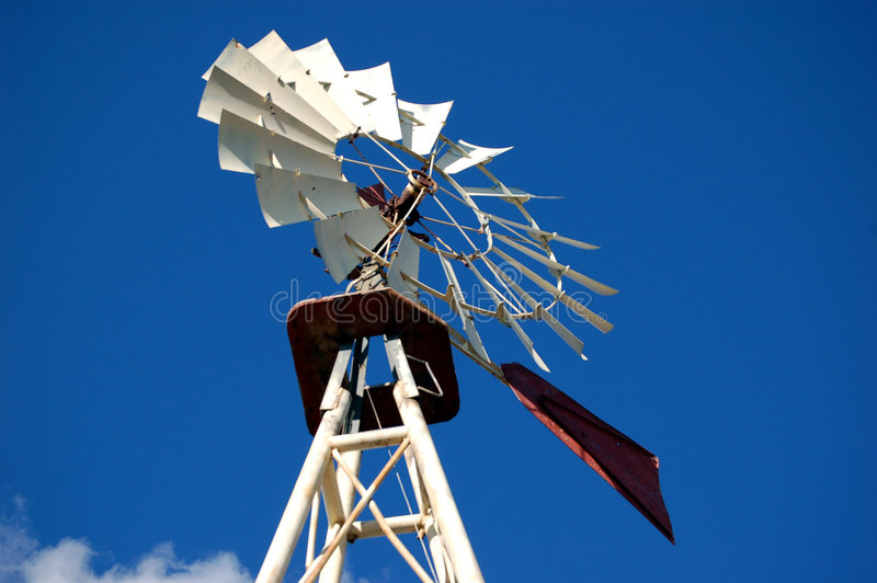 Old Ranch Windmill. Windmill found on an old ranch in the southwest used for pumping water for cattle royalty free stock photo