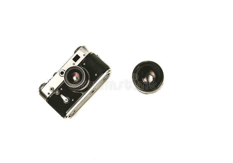 Old rangefinder vintage camera on white background stock image
