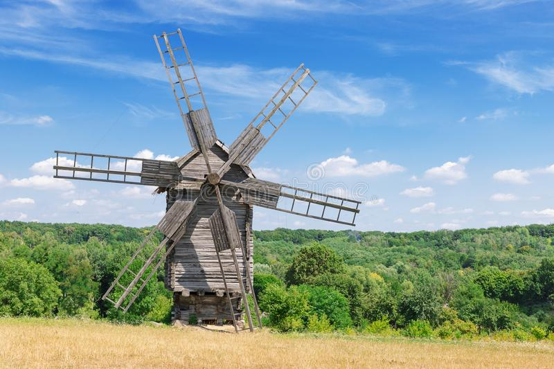 Old Rare Ancient Wooden Windmill in front of Cloud Sky royalty free stock photography