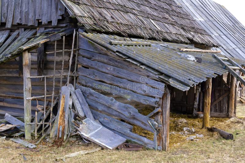 Old rare vintage ruined rustic wooden barn house - landscape. Old rare vintage ruined rustic wooden barn house - abandoned landscape royalty free stock photography