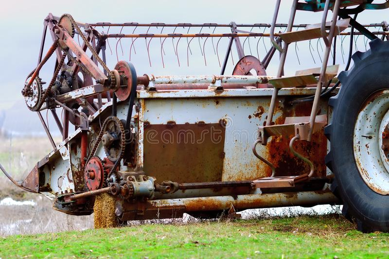 The old reaping machine. Was prepared and repaired for harvesting wheat stock photo