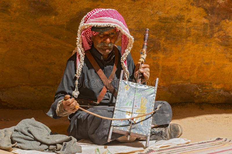 Old Rebab Bedouin player with his self made instrument singing in the Petra desert Jordan. royalty free stock photos
