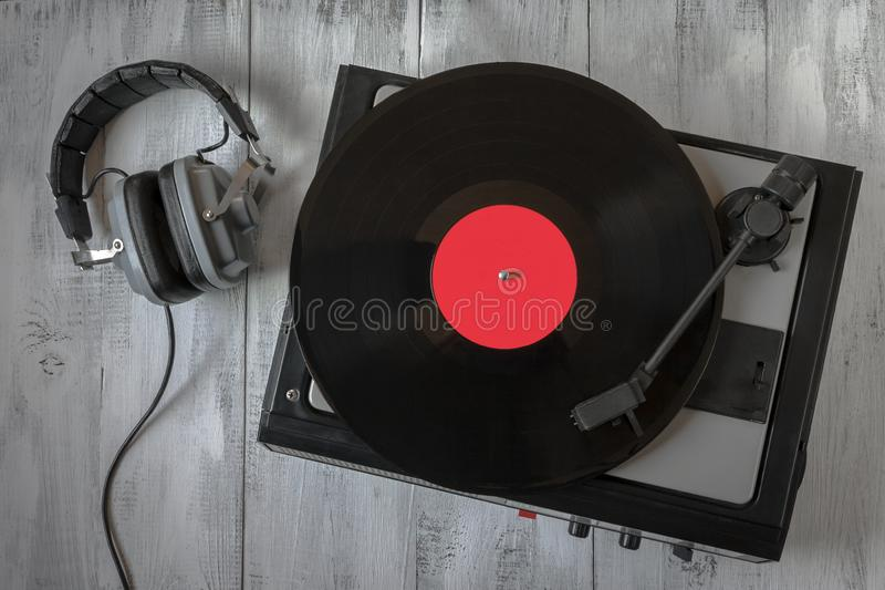 Old record player for vinyl records and headphones royalty free stock photo