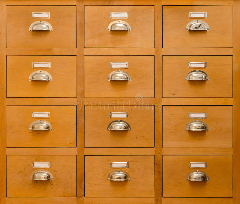 An old rectangular cabinet with twelve drawers stock images