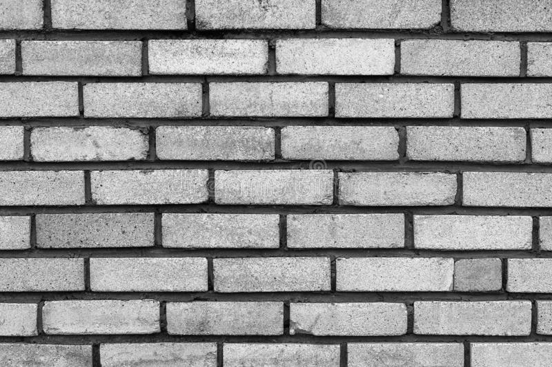 The old rectangular grey brick wall texture background.  stock photo
