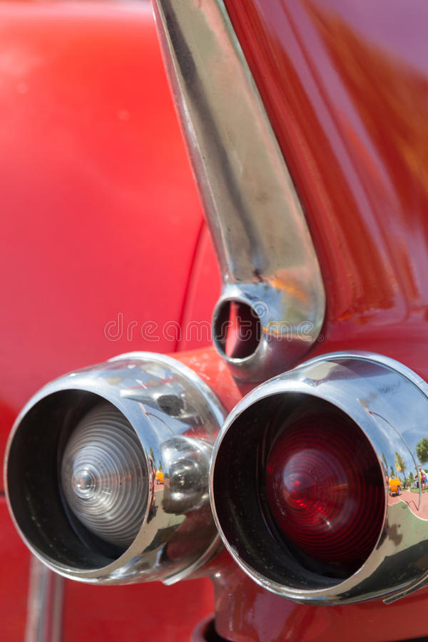 Old red automobile. Rear part. stock images