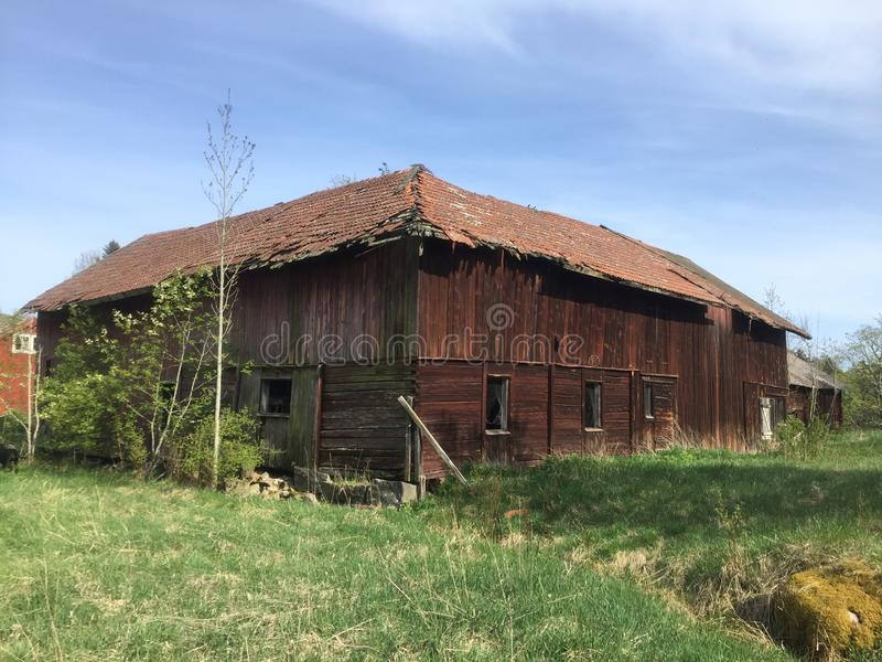 Old red barn falling down - ruin - sweden royalty free stock image