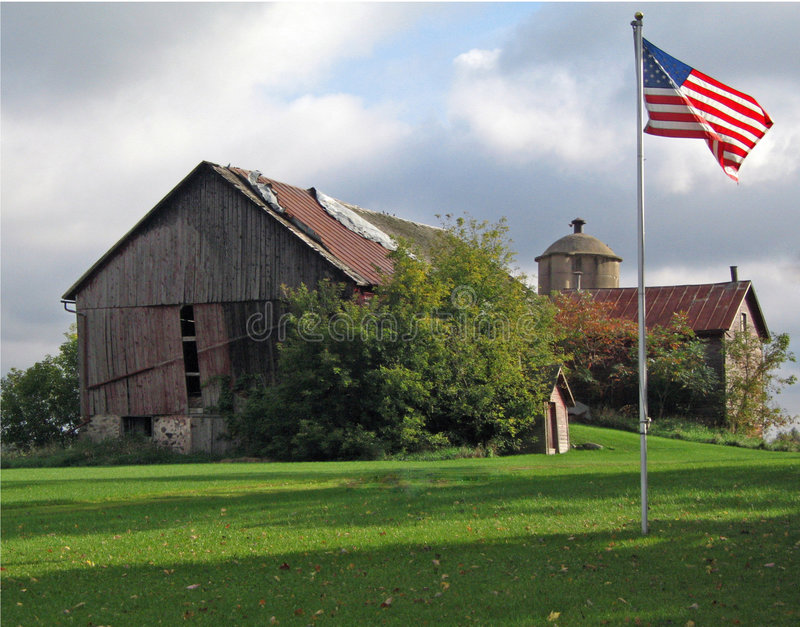 Download Old Red Barn with Flag stock image. Image of shadows, independence - 4452943