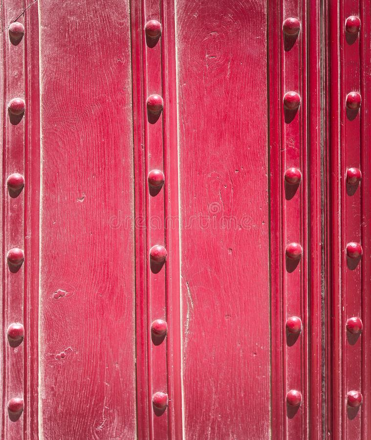 Old red boards and metal rivets. Backgrounds and textures.  stock images
