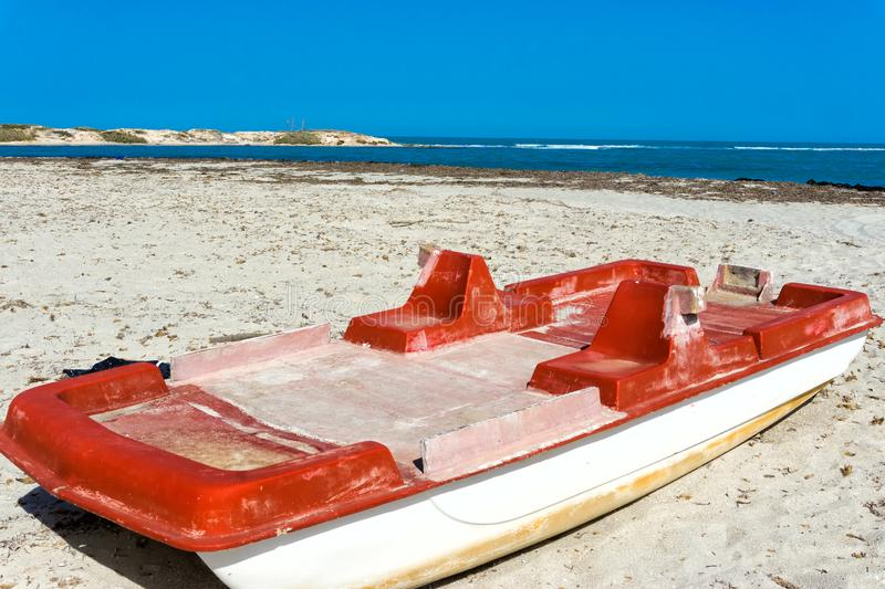Old Red Boat on the Shore of the Mediterranean sea in Djerba, Tunisia. Landscape of old red boat on the shore of the Mediterranean sea in Djerba, Tunisia stock image