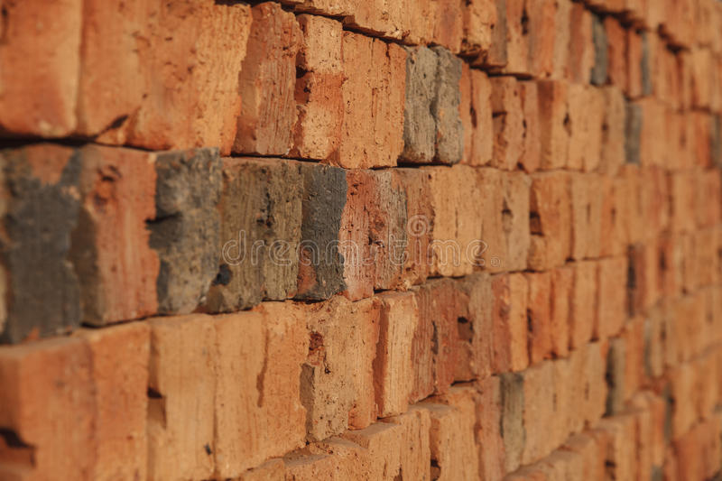Old red brick arranged in a row