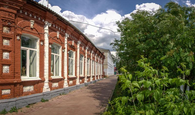 An old red brick building in Central Russia. In Russian ancient Philistine cities preserved many old stone houses, built in the architectural traditions of stock photo