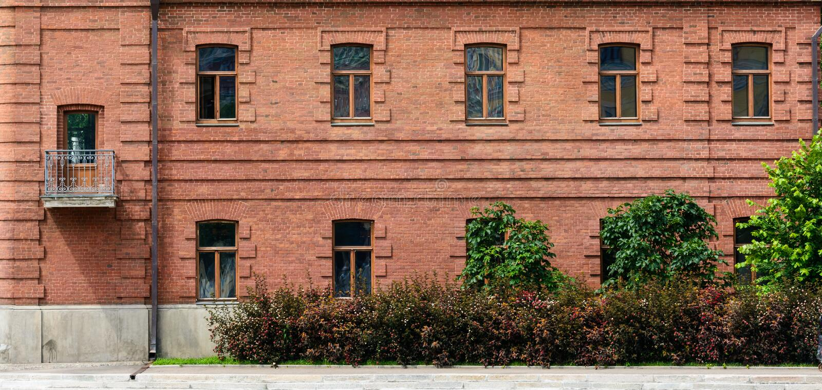 Old Red Brick Building Facade. Red Brick Building facade. Vintage architecture classical stock images