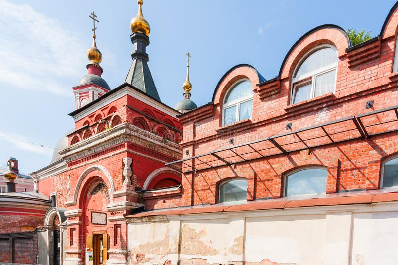 Old red brick church with golden domes royalty free stock image
