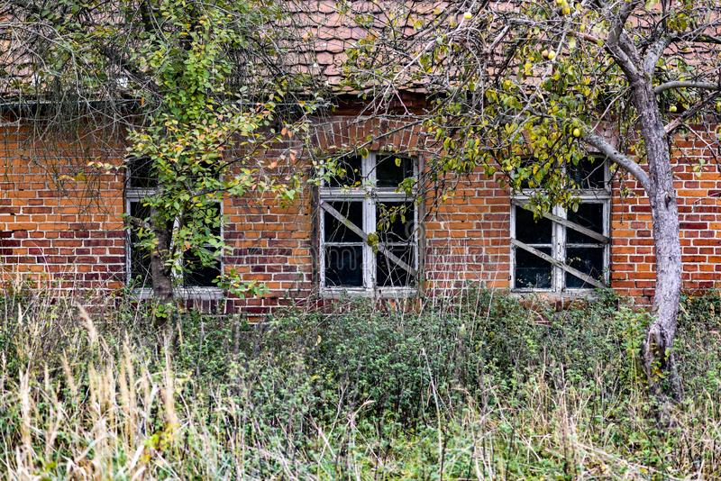 An old red brick hut on a village in Poland royalty free stock images
