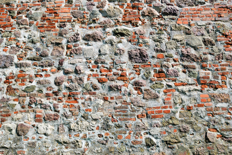 Old red brick stone wall stock photos