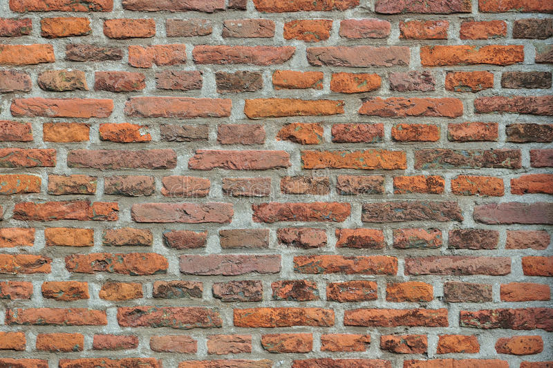 Old red brick wall. A detailed view of an old red brick wall stock images