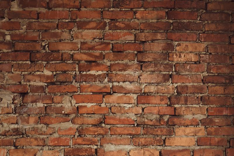 Old red brick wall background texture. Retro pattern with old red brick wall. Grunge background. Space texture. Brown retro rough stock image