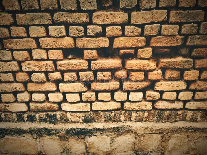 Old Red brick wall background textured. Vintage brick wall texture stock photo