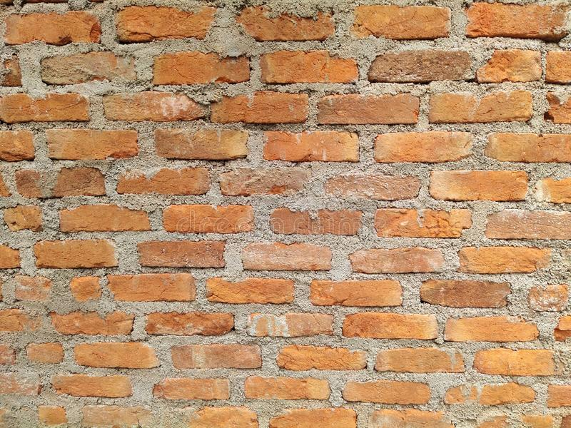Old Red brick wall background textured. Vintage brick wall texture royalty free stock photo
