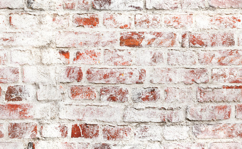Old red brick wall with damaged white paint royalty free stock photos