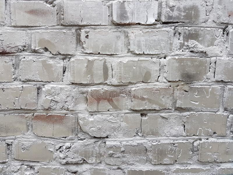 Old red brick wall with damaged white paint layer, closeup background photo texture. Seamless composition royalty free stock photos