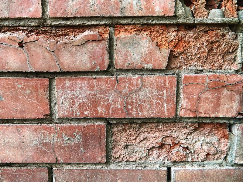 Old red brick wall. Destroyed surface of the masonry. royalty free stock images