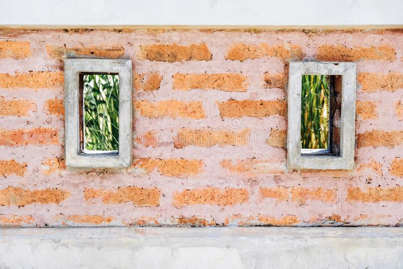 Old red brick wall  with double squares, wallpaper texture background royalty free stock images