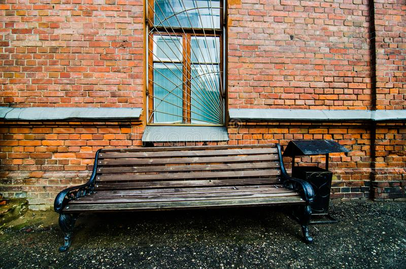 Bench Beside A Red Brick Wall Stock Image Image Of Brick