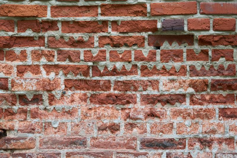 Old red brick wall of rectangular shape with triangular cutouts stock images