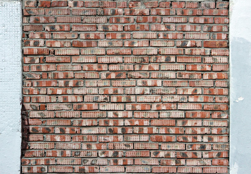 old red brick wall relief, cross brickwork, framed by white edges on the sides. royalty free stock images