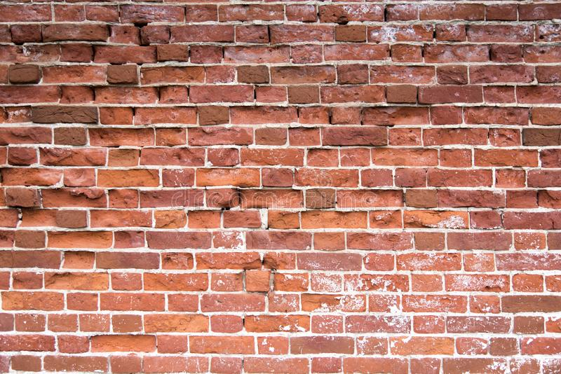 Old red brick wall texture background. Distressed wall with broken bricks texture. Old red brick wall texture background. Old brick wall with cracks and royalty free stock images