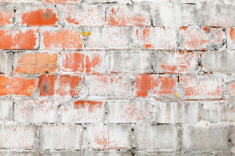 Old red brick wall with white paint stock image