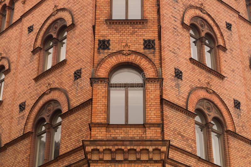 Old red brick wall with windows background stock image