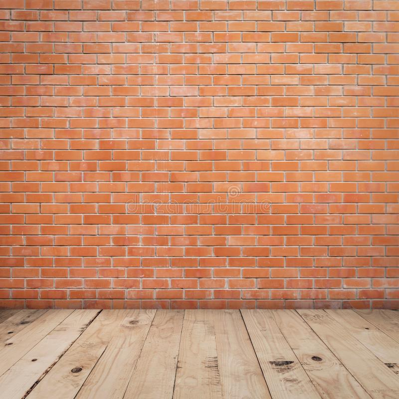 Old red brick wall and wood floor background and texture with copy space royalty free stock photos