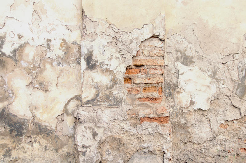 Old red brick and white plaster wall with cracked shabby surface texture background. royalty free stock images