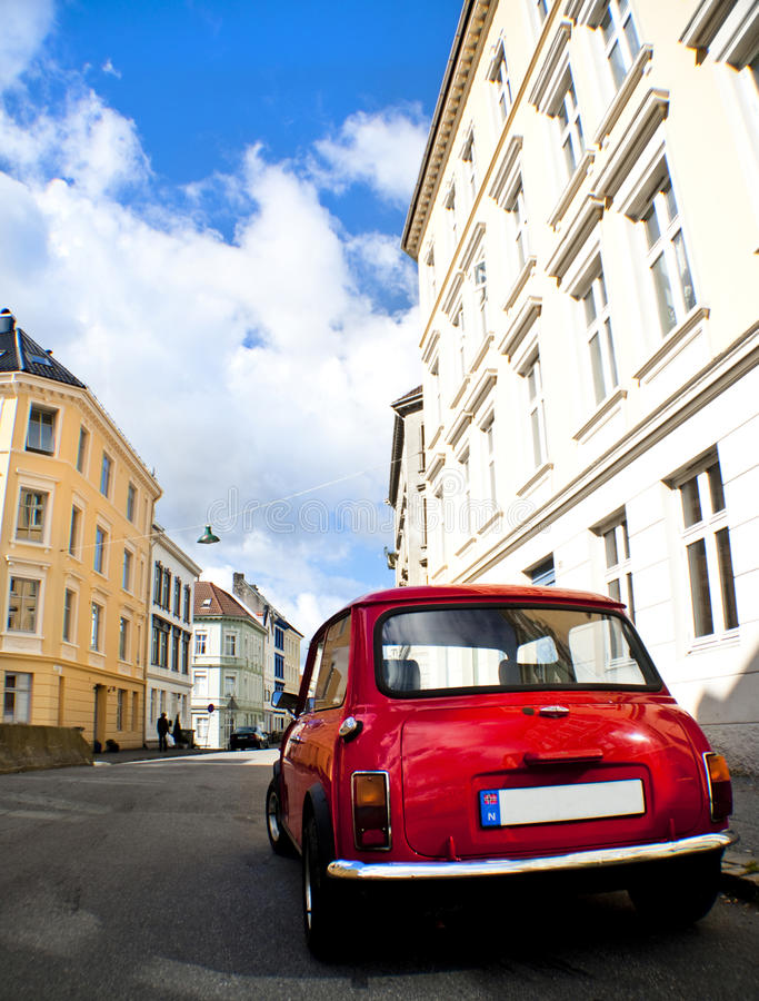Old red car in a street. Europe 2014 royalty free stock photos