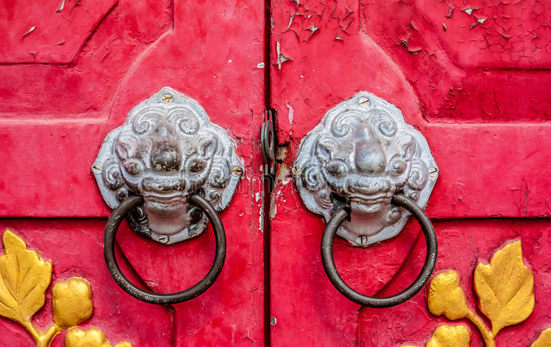 Old red chinese temple door with crave leaf.  stock photos