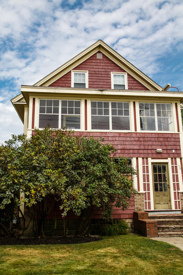 Old Red Clapboard House. An old red clapboard house with yellow trim royalty free stock images