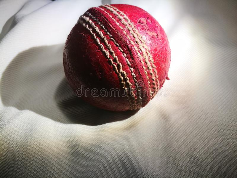 Old Red Cricket ball stock photography