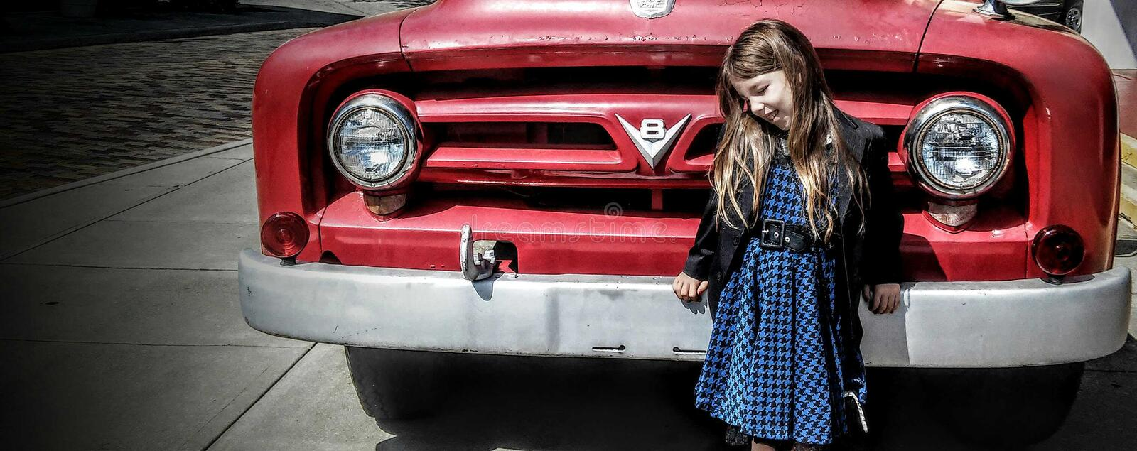 Old red engine and young blue girl royalty free stock photography