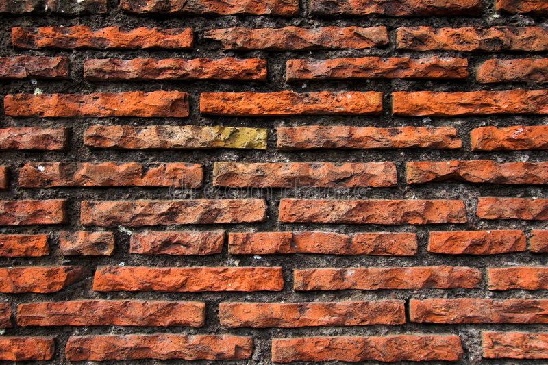 Old red and grey brick wall, t royalty free stock photos