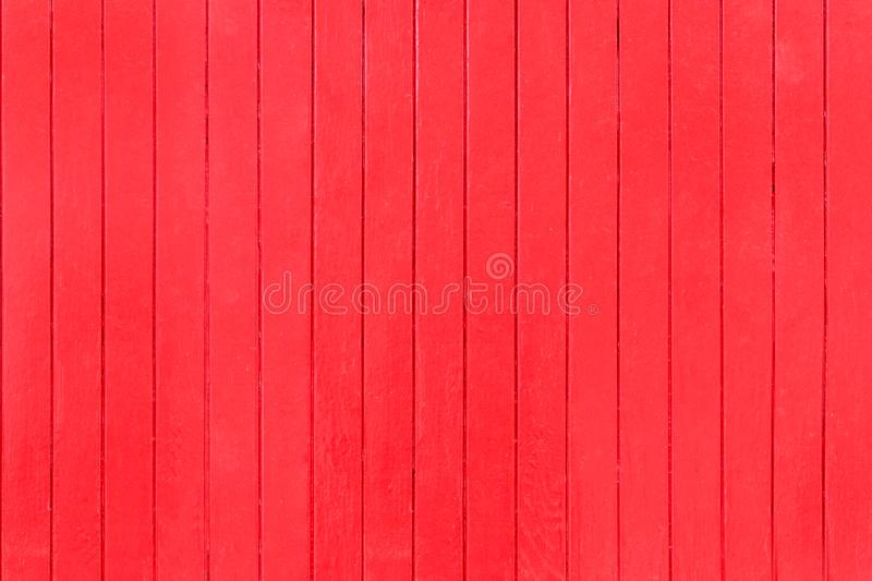 Old, red grunge wood vertical panels on a rustic barn royalty free stock photography