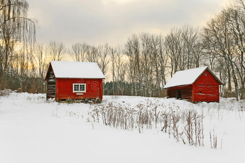 Old red houses in a winter landscape. Old red houses in a snowy landscape. Swedish winter stock photos