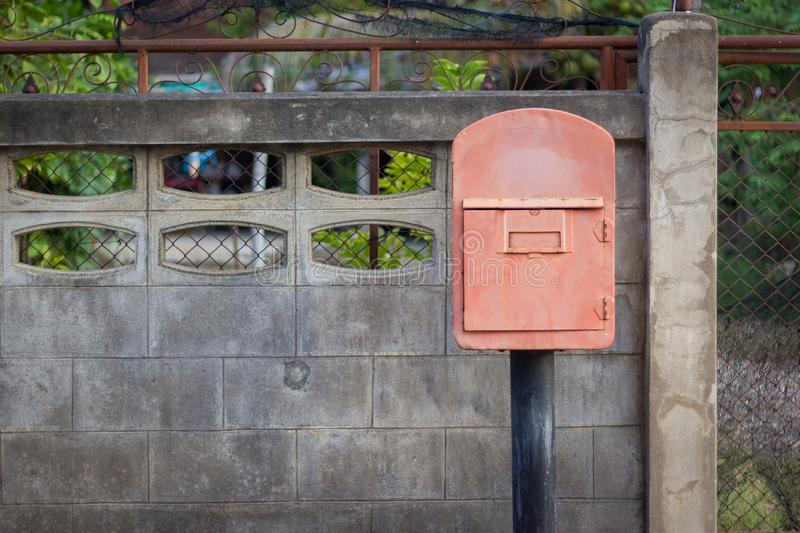 Old red mailboxes at front yard stock images