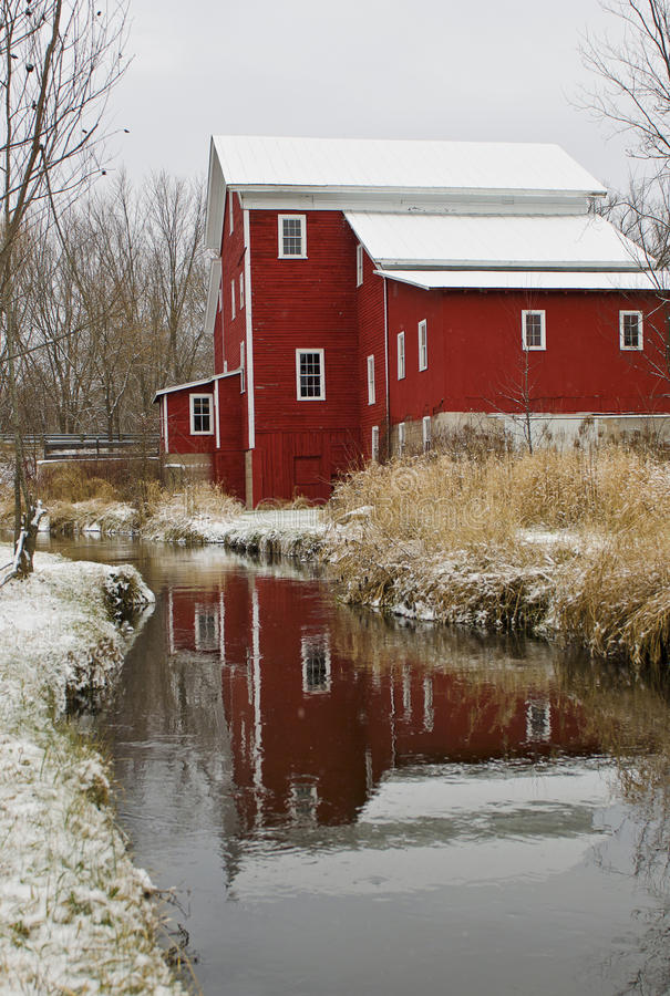 Old Red Mill on River. Beautiful, old red mill on river with reflection stock images