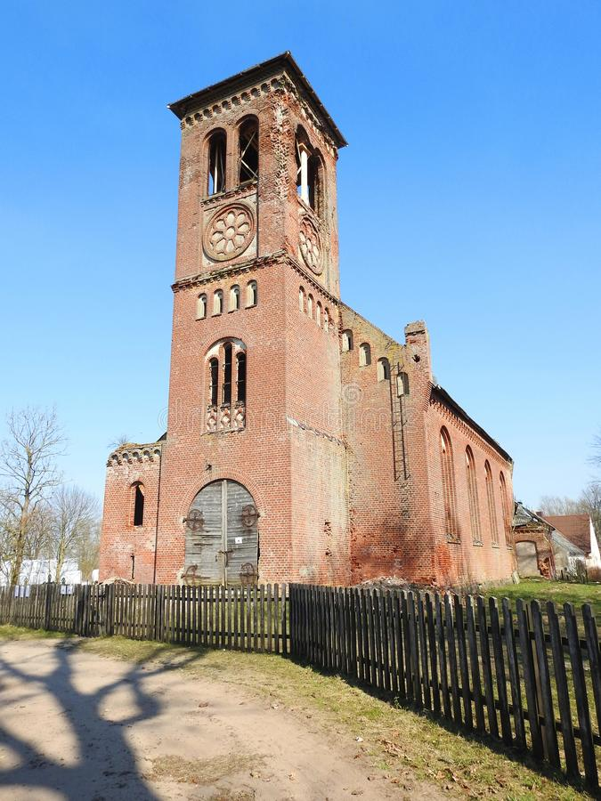 Old red not working church, Lithuania stock image