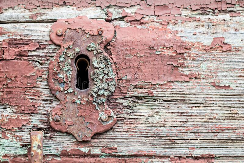 Old red paint rusty antique door keyhole or lock royalty free stock image
