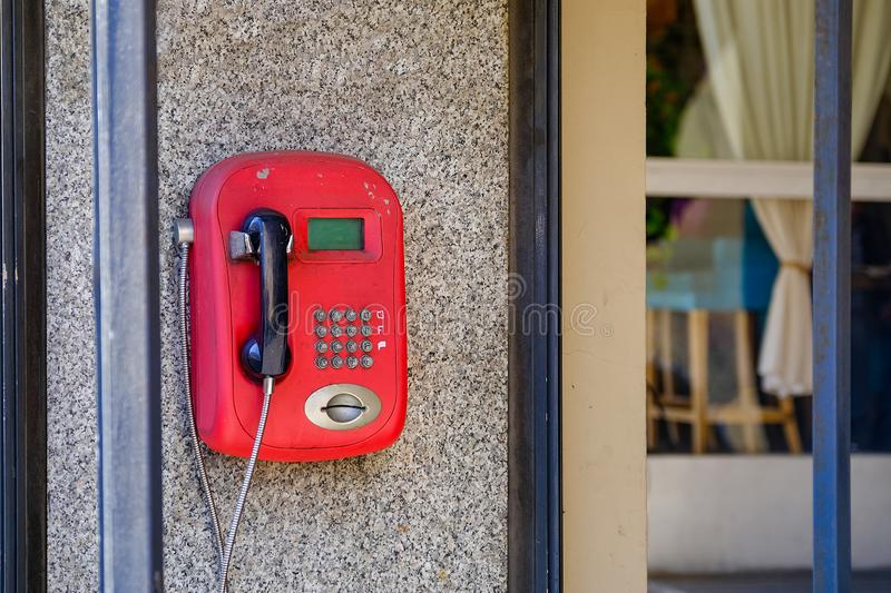 Old red pay phone. Payment was made by cards. Now the rarity does not work.  stock image